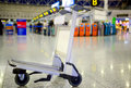 Empty metal cart for luggage standing at airport