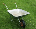 Empty metal wheelbarrow. Stock Images