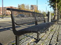 Empty modern benches under the sun Royalty Free Stock Photo