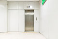 An empty modern elevator or lift with metal doors that are open