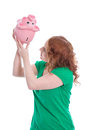 Empty moneybox young woman with piggy bank isolated disappoint looking in it on white Stock Images