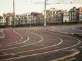 Empty morning street of Amsterdam city, before traffic on sunrise