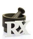 Empty mortar and pestle with white wooden rx letters isolated Royalty Free Stock Photo