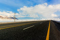 Empty motorway and clouds meet in vanishing point Royalty Free Stock Photo
