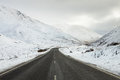 Empty mountain road on a cloudy winter day south island new zealand Royalty Free Stock Image