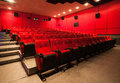Empty movie theater big with red seats Royalty Free Stock Image