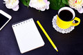 Empty notebook and yellow cup with coffee Royalty Free Stock Photo