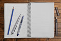 Open blank notepad with empty pages with a pencil