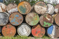 Empty oil barrels rusty and weathered on top of each other Royalty Free Stock Photo