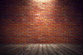 Empty old grungy room with red brick wall and wooden floor. 3d Royalty Free Stock Photo