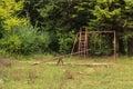 Empty old swing in abandoned soveja resort romania Stock Photos