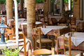 Empty oudoor cafe tables with selective focus image of Stock Images