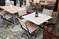 Empty outdoor restaurant tables on kurfurstendamm in berlin in autumn Royalty Free Stock Photography