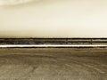 Empty parking with guardrail, grainy sepia hue Royalty Free Stock Photo