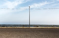 Empty parking with lamppost an overall view of an a single just in the middle of it a cloudy sky in the background landscape cut Royalty Free Stock Photos