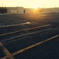 Empty parking near a shopping mall at sunset Royalty Free Stock Photo