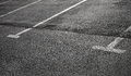 Empty parking places on dark asphalt with white lines Royalty Free Stock Photography