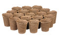 Empty peat pots isolated over white background Stock Images