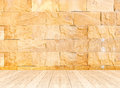 Empty perspective room with sand stone wall and wooden plank flo Royalty Free Stock Photo