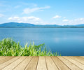 Empty perspective wood over lake and blue sky background, spring Royalty Free Stock Photo