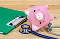 Empty piggy bank with stethoscope. Royalty Free Stock Photo