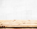 Empty pine wood table with white wall background. Royalty Free Stock Photo