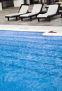 Empty plank beds before pool Royalty Free Stock Image