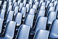 Empty plastic chairs at the stadium with toning effect Royalty Free Stock Photo