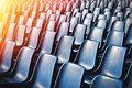 Empty plastic chairs at the stadium with toning effect Royalty Free Stock Image