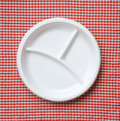 Empty plastic plate checkered cloth Royalty Free Stock Images