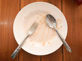 Empty plate left after lunch Royalty Free Stock Photo