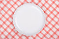 Empty plate over checkered background white Stock Photography