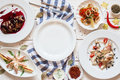 Empty plate in seafood snacks frame flat lay void Royalty Free Stock Photo