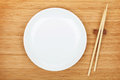 Empty plate and sushi chopsticks Royalty Free Stock Photo