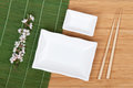 Empty plates, chopsticks and sakura branch Royalty Free Stock Photo