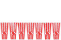 Empty pop corn containers row of on white Royalty Free Stock Photo