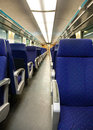 Empty railway carriage with blue seats Royalty Free Stock Photo