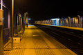 Empty railway station at night with a single person waiting the photo of in italy tuscany Royalty Free Stock Images