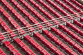 Empty range of red seats in a stadium Royalty Free Stock Photo
