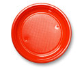 Empty red plate plastic with shadow on white with clipping path Royalty Free Stock Images