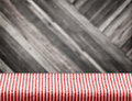 Empty red strip table cloth with blur diagonal wood plank wall, Royalty Free Stock Photo