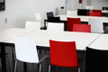 Empty red and white tables and chairs in a cafeteria or venue for eating a meal or holding a meeting Stock Photography