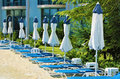 Empty resort a row of sunbeds with umbrellas in the Royalty Free Stock Photo