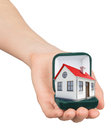 Empty ring box with house in womans hand