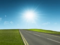 Empty road bright sun rays Stock Images