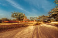 Empty road going through rural landscape under sunset sky myanmar amazing architecture of old buddhist temples at bagan kingdom Stock Images