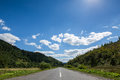 Empty road and mountains on background of the cloudy sky Royalty Free Stock Photo