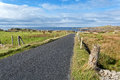 Empty road running through donegal coast natural landscape of northern of ireland Royalty Free Stock Image