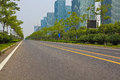 Empty road surface with modern city buildings background straight line Stock Photos
