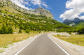 Empty road to Theth village in Albanian mountains Royalty Free Stock Photo